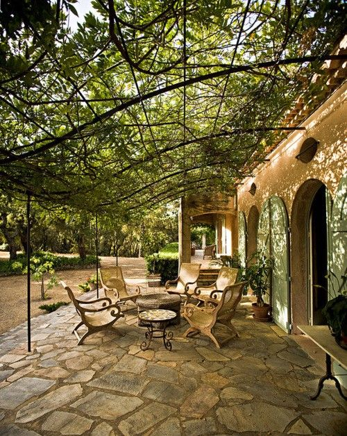 Covered patio area with a trellis
