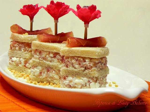 Italian food  Tramezzini con mousse di prosciutto crudo ai fiocchi di latte con granella di nocciole