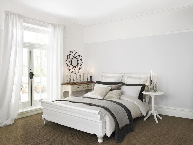 sophisticated pale grey bedroom painted with crown matt emulsion in