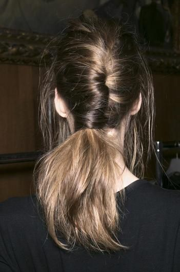 This beautiful look is created by rolling hair from one side into the middle of the head. Use bobby pins to secure the wrapped hair. The twist will naturally create a ponytail around the remainder of hair, so secure that with an elastic. Pull down a few hairs framing your face for a tousled look in the front.