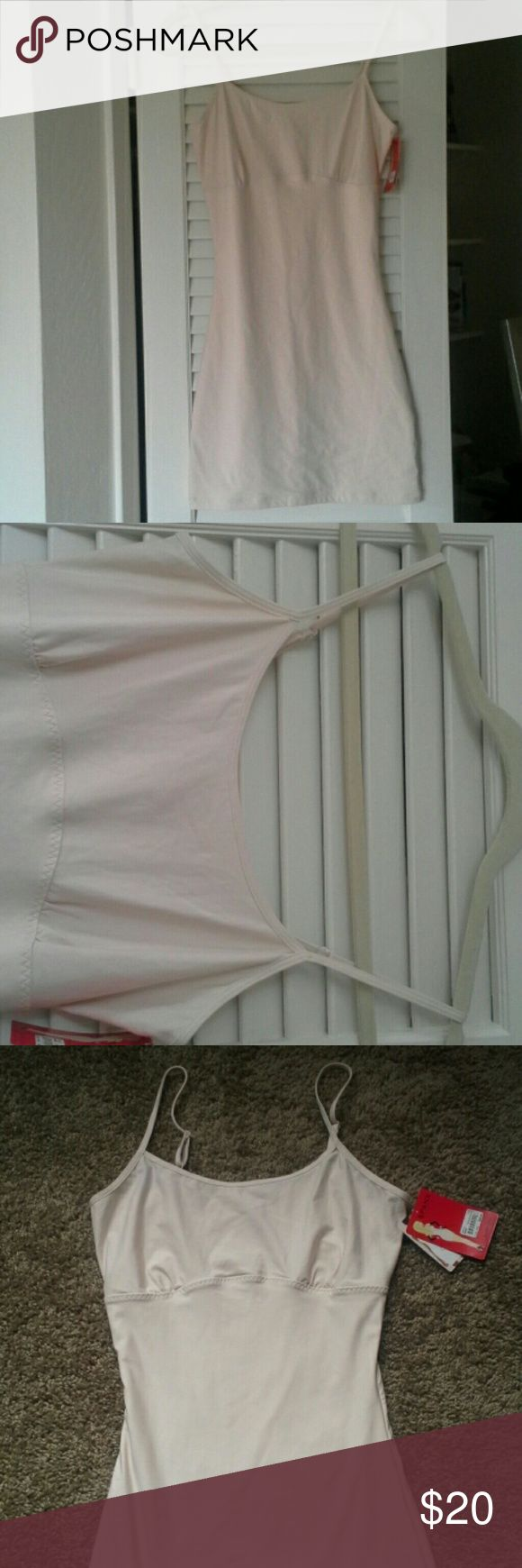 Spanx slip Brand new adjustable strap spanx slip .  Top to bottom measures 26.  Cotton lightweight.  Double layer tummy control.  Great for under your spring and summer dresses. SPANX Intimates & Sleepwear Chemises & Slips