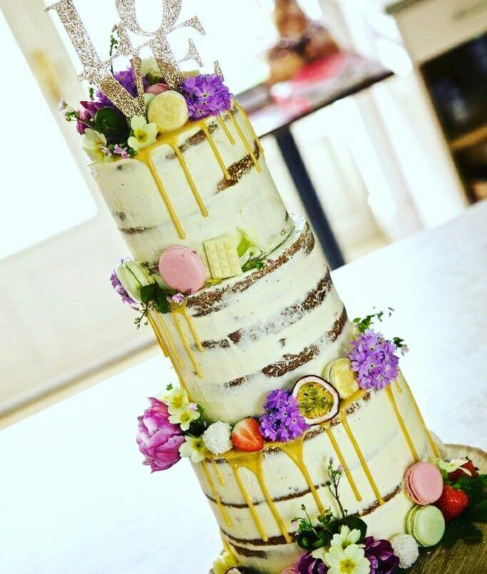 Semi naked golden drip wedding cake with macarons and fresh flowers - perfect for a rustic countryside wedding!