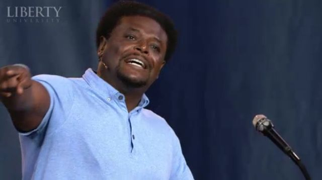 """Derwin Gray, founder and pastor of Transformation Church and author of """"Limitless Life"""" speaks to 10,000 students at Liberty University's convocation in Lynchburg, Va., on Sept. 6, 2013."""