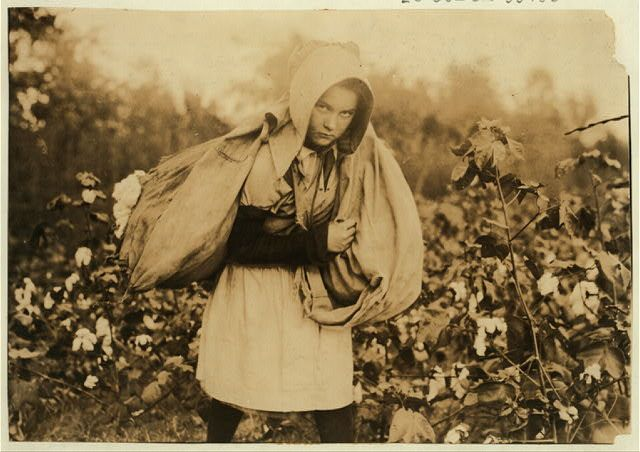 """Callie Campbell, 11 years old, picks 75 to 125 pounds of cotton a day, and totes 50 pounds of it when sack gets full. """"No, I don't like it very much."""" Potawotamie County, Oklahoma. photo by Lewis W. Hine."""