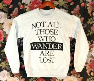 Love this sweater. It's a quote from the LOTR in the First Book, Gandalf's leter to Frodo. :D