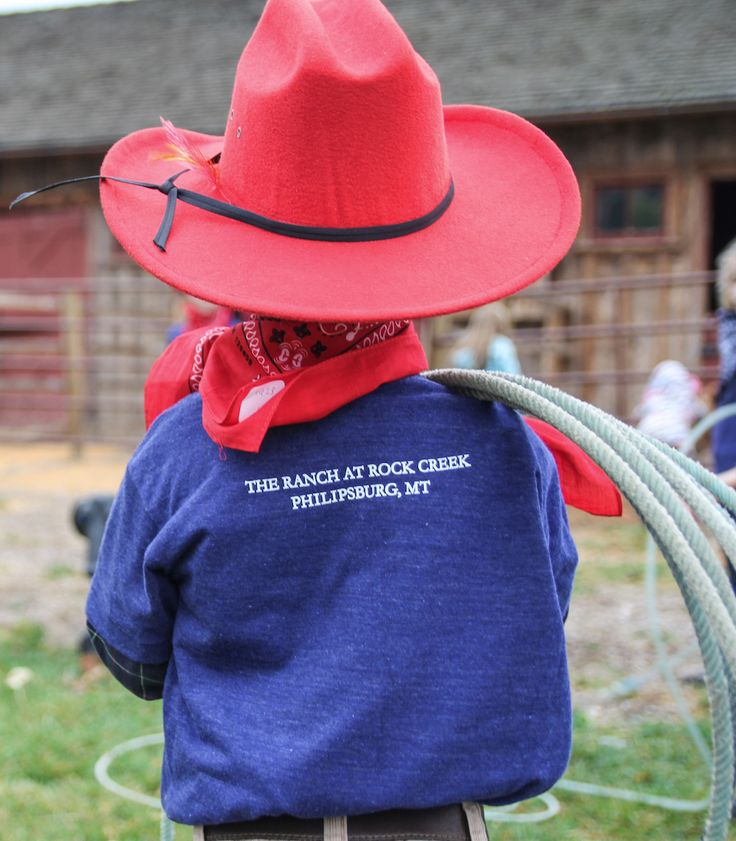 "During ""Ranch Life Day"" at The Ranch at Rock Creek, young travelers adopt a horse for the day. Wranglers teach kids about horse safety and care, followed by a group ride and roping practice. 