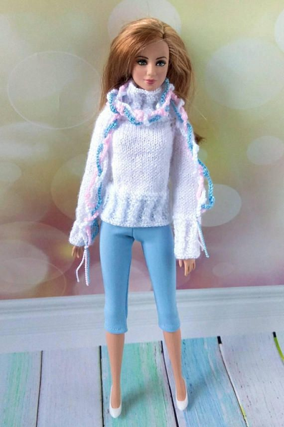 Barbie doll clothes. Hand-knitted white sweater blue leggings