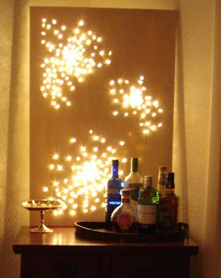 canvas + xmas lights = easy cool art. Put in bedroom where AC was. Write something cute for master bedroom.