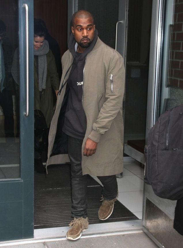 Kanye West Wears Fear of God LA Long Bomber Jacket And Visvim Sneakers