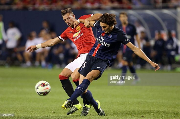 Morgan Schneiderlin of Manchester United and Adrien Rabiot of PSG in action during the International Champions Cup 2015 game