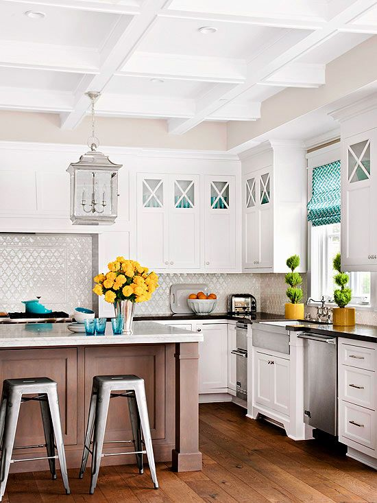 A trend setting stylish kitchen, for sure!  Love the mix of updated formal with the modern stools!