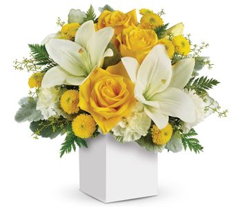 """Buy """"Golden Laughter"""" for $79.95. What A Stylish Way To Make Someone Smile! Inspired By The Sunny Sound Of Children's Laughter, This Light Hearted Arrangement Of Golden Roses And Fragrant White Lilies Is Sure To Please.  Flowers Are Subject To Seasonal Availability. In The Event That Any Of The Flowers Are Unavailable, The Florist Will Substitute With A Similar Flower In The Same Shape, Style And Colour. Stem Count, Packaging And Container May Vary. Standard (pictured Price) : Wn5"""