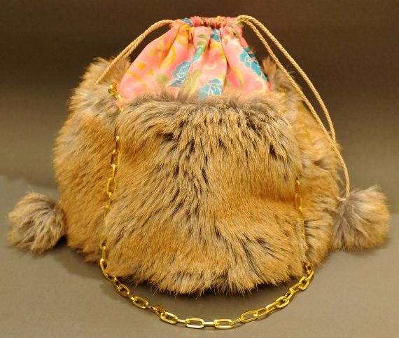 "Handmade pouch bag 25x25 cm,  with high quality beige-brown faux fur, floral fabric, pink satin internal coating with a small pocket case. The pouch closes with a gold fabric cord, with faux fur pom poms at the ends and can be hold by gold metal chain handles. <br>A fabulous ""must have""  bag...  Find it @ https://www.facebook.com/frabala.gr?ref=hl"