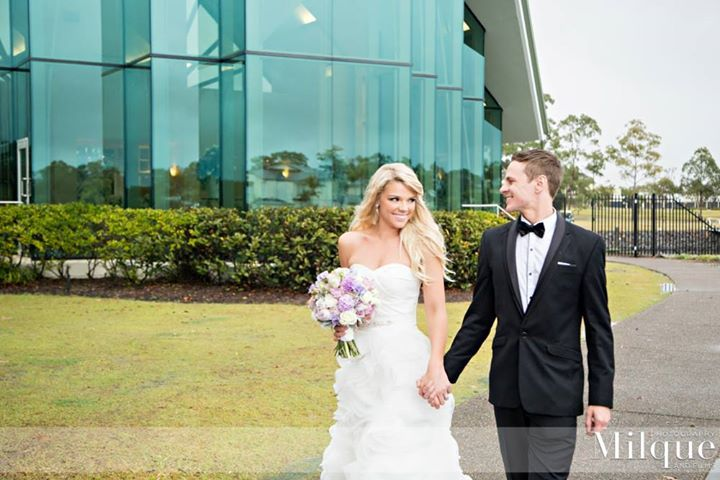 Beautiful wedding photograph. Bride, groom, purple flowers, at the InterContinental Sanctuary Cove Resort, Gold Coast