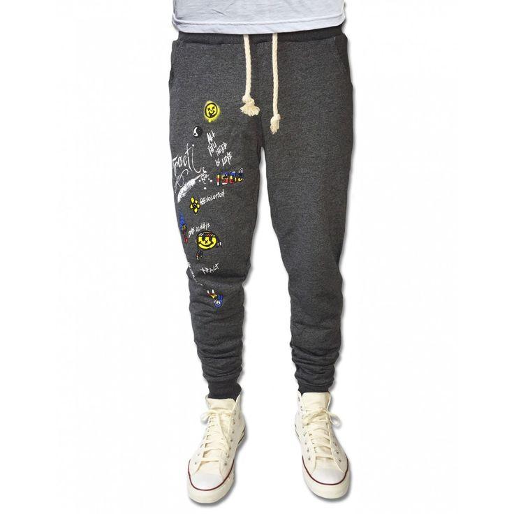 JOGGING MAN BLACK HIPPIE DISEGNATA.TRACT BRAND.MADE IN ITALY. Pantalone disegnato uomo. 100% cotone Col. Nero. Tasche laterali. Stampa laterale.  € 59,90  http://www.tractshop.it/uomo-32/felpe/jogging-man-black-hippie-disegnata.html