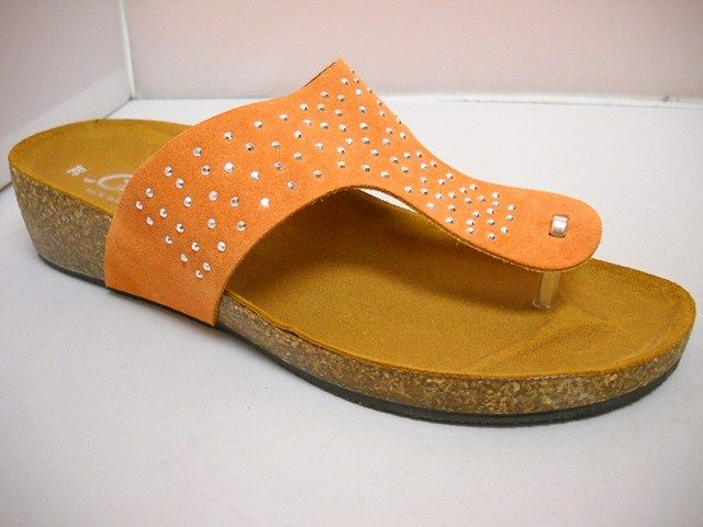 Carosello from Italy.  Summer slide and travel toe thong style. Diamante features on 4cm cork sole.  Available in White and Orange.  Sizes range 37-41.
