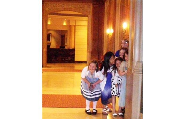Earlier this year, I was waiting for a bride who was taking pictures in the lobby of the hotel. I captured this photo of little girls giggling as they spied the bride.