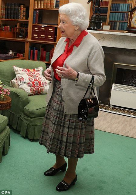 9.20.2017 The Queen in a red blouse, cardigan and tartan skirt today. What do you suppose HM needs with a purse while in her own library? 🌝