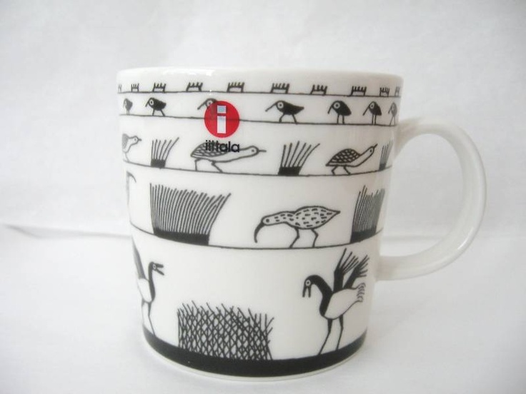 Iitala Finland. Oiva Toikka Anniversary Birds mug, grey. In celebration of more than 50 years of Toikka's work at Arabia Pottery and Nuutajarvi glass works. In 1992 he became the first recipient of the Kaj Franck Design Prize for his contribution to the art of glass, and design in general. From one master to another.