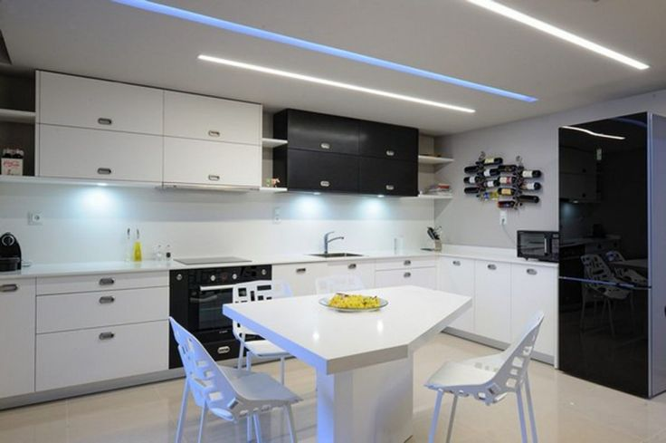 Interior Modern Apartment Design: Bladdery Sharp Tip Modern Apartment Inspiration With Hollow Design Chairs Plus Suitable White Table And Black White Kitchen Storage Combination Also Wine Bottle Wall Shelf