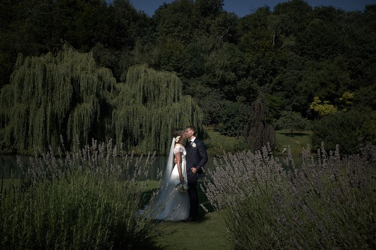 Beautiful #BrideandGroom #Portrait from #BusbridgeLakes in #Surrey. #LowKEY #Dark #photograph #photographer #photos #wedding #weddingdress #groom #suit #bride #