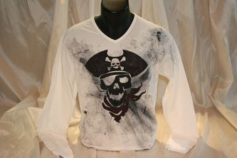 Hand painted and hand stenciled men's t shirt featuring a pirate skull. The colors are non-toxic, water based, permanent fabric colors.