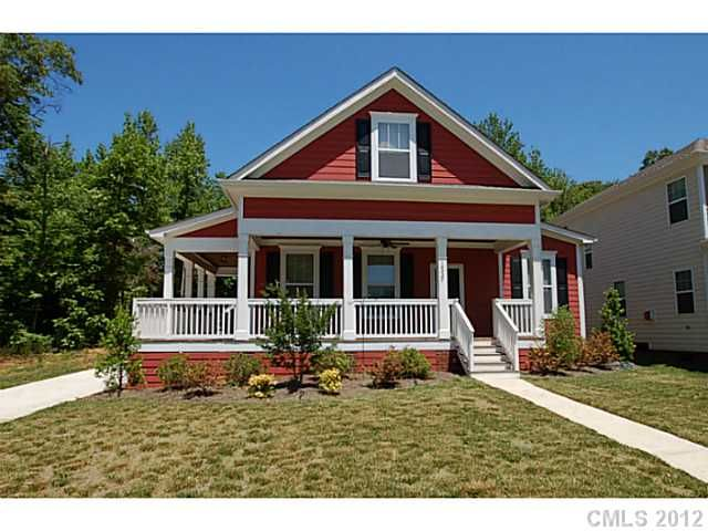 Red craftsman style home with wrap around porch charming for Craftsman wrap around porch