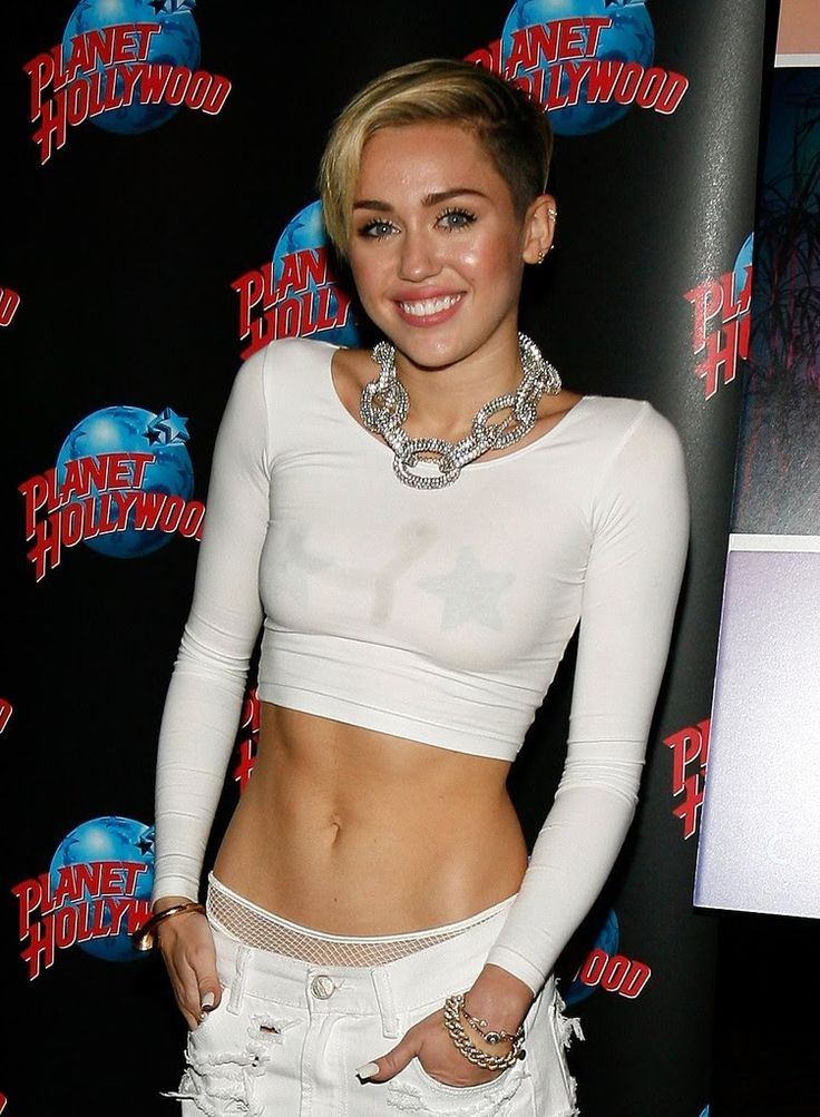 Miley Cyrus admits she's a REPTILIAN in new SNL teaser skit, while addre...