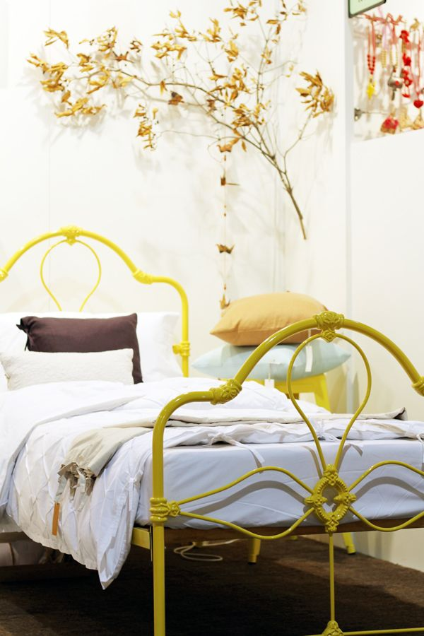 yellow wrought iron bed