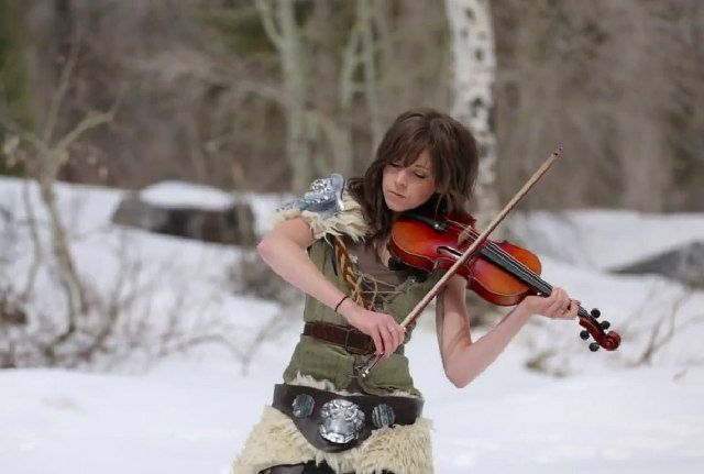 Lindsey Stirling!!  Skyrim music video. An incredible young artist. She is wonderfully, magically playful and talented. Carol