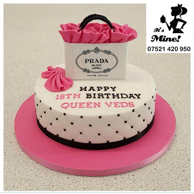 A White And Pink Black Quilted Birthday Cake With A Prada