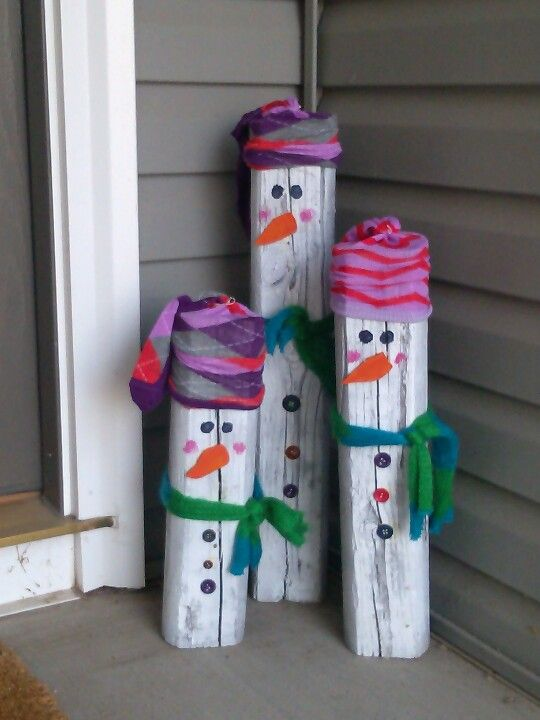 Super cute snowmen.  I used a landscape timber and cut it into three different lengths.  I painted them white.  Used .paint for the eyes and cheeks.  I cut the nose out of wood, painted it orange and glued it on along with the buttons.  The hats are long socks and the scarf is an old one I had that I cut into thirds.  Super easy and so adorable!