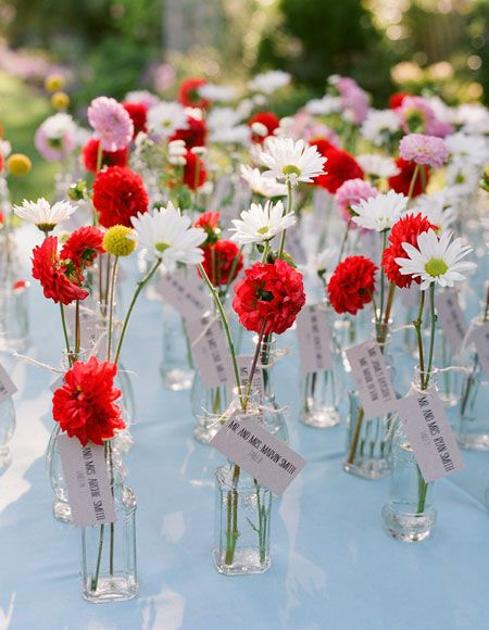 Aisle Say : Brides; This could take care of seating, centerpieces and favors!  Any flowers, different sizes, this could be really neat. Sort of a choose your own adventure of centerpieces.
