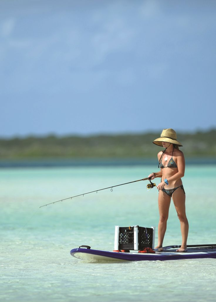 Paddle boarding and fishing combination. Photo by Big Pine Key Fishing Lodge CC BY