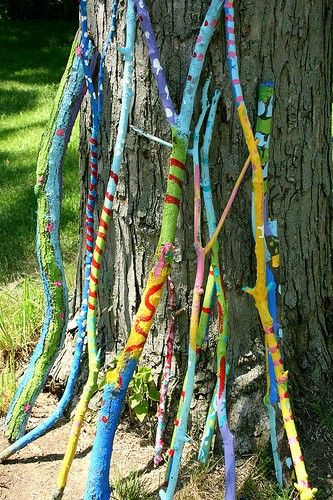 Add some color to your garden- let your children use their imaginations by painting on sticks/branches :):