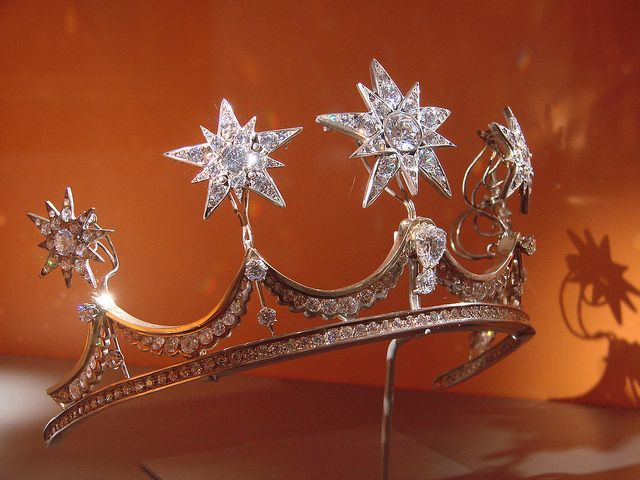 Replica of tiara created for the wedding of the (then) Prince of Orange & Maxima Zorreguieta. Queen Emma's star brooches of c1890 were attached to the base of the Pearl button tiara, itself an amalgam tiara composed of a base from a tiara belonging to Anna Pawlova, consort of Willem II, and pearl buttons that belonged to her successor, Sophie of Wuttermberg. Queen Maxima wears the tiara in both forms. This replica was created for an exhibition that included her wedding dress.