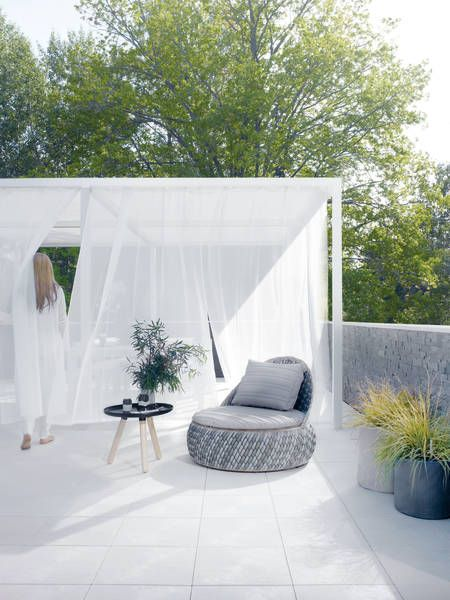 A terrace made from UPM ProFi Floor composite tile in Marble White colour.
