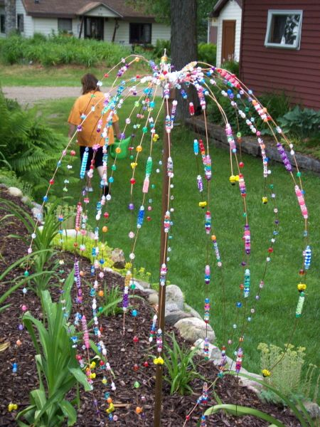 Bead tree for garden. Looks like wire and copper pipe