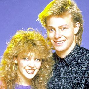 Oh the fashion, the hair of the 80s! Young Kylie Minogue with manfriend.