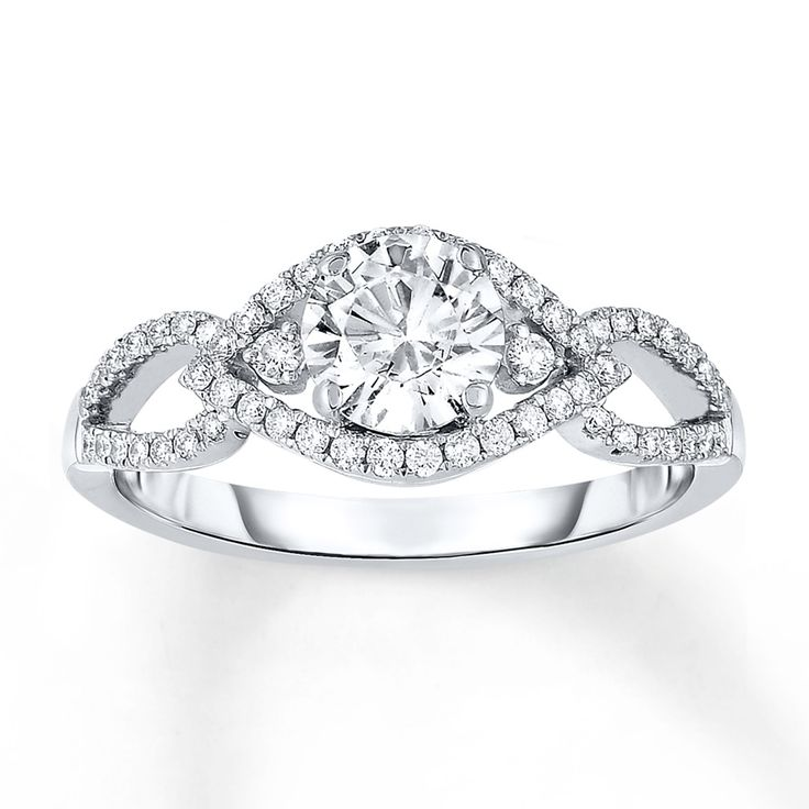 Cool A brilliant round diamond shines at the center of this elegant engagement ring u