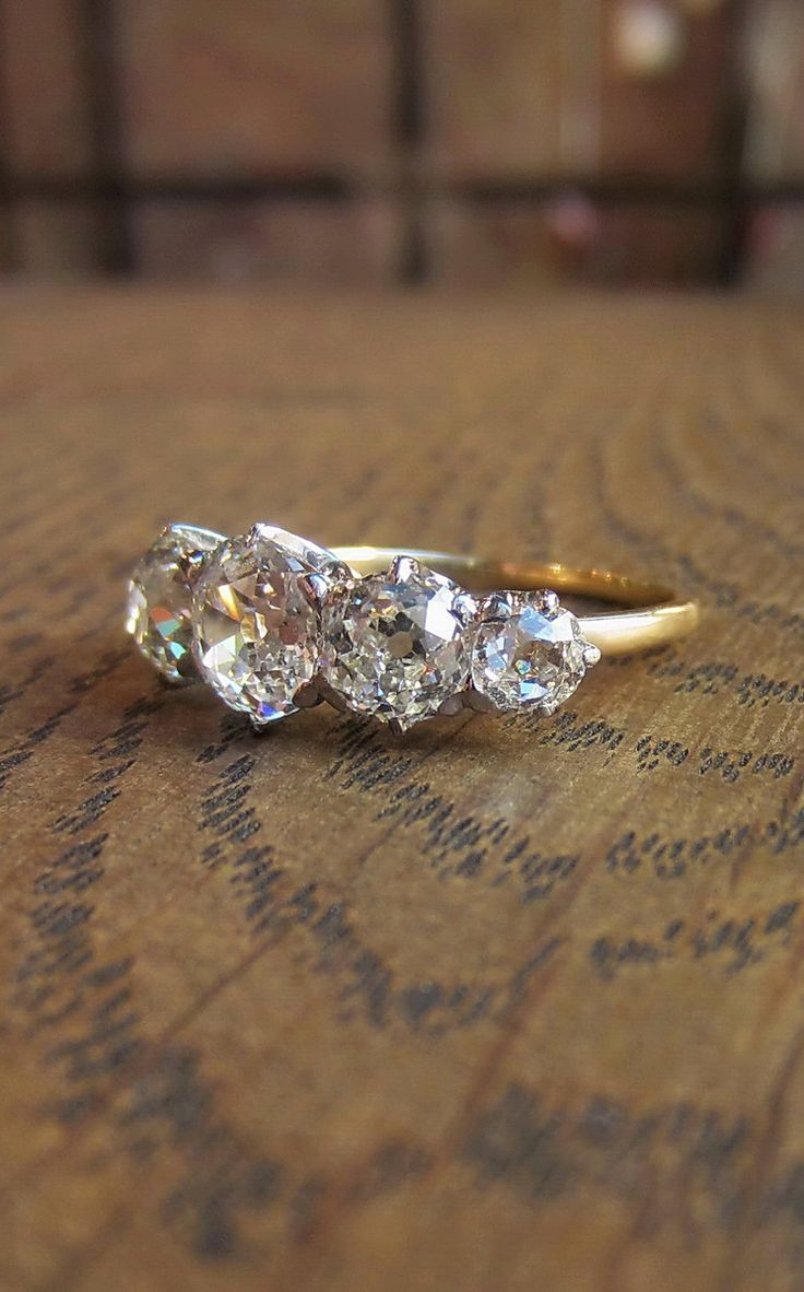 Antique Victorian diamond five stone engagement ring in gold, from Doyle & Doyle...