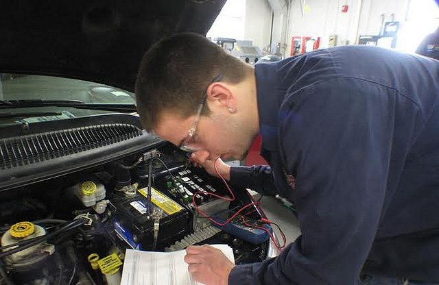 Student working on a vehicle during the Traditional Automotive Apprenticeship, which allows students to attend classes for two months at a time in intervals of three.