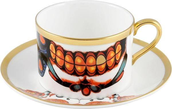 'Inkhead' Coffee Cup & Saucer, featuring the very vibrant teeth from the 'Inkhead' skull and special 22kt gold tooth. Taking inspiration from tattoos and edgy art, 'Inkhead' features a vibrant and bold skull design full of colour and detail. Hand gilded 22kt Gold rim and accents – gold tooth, made in Stoke-on-Trent, England. Fine Bone China. Find out more here: https://thenewenglish.co.uk/collections/inkhead #TheNewEnglish #Inkhead #Tattoos