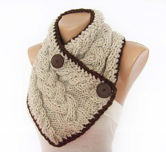 This chunky cabled scarf / neck warmer is hand - knitted of bulky wool / acrylic blend yarn. It is thick and warm. It has brown crochet trim and big