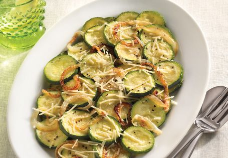 Zucchini is so tasty when it's topped with caramelized onions and shredded Parmesan.