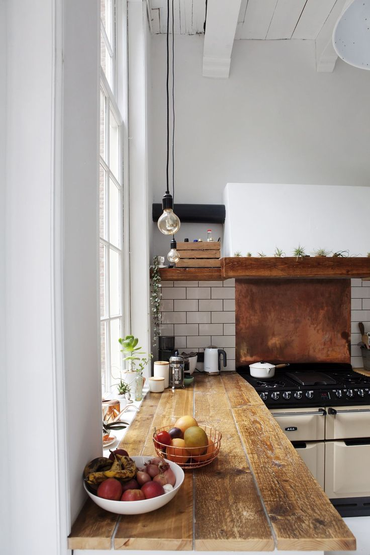 Rustic wooden bench, subway tiles, open shelves, vintage oven farmhouse inspired kitchen