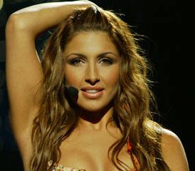 """Elena Paparizou was born on January 31, 1982. She is a great young singer.    Biography and Career :    Georgios and Efrosini Paparizou are her parents and they come from Volos and Karditsa, Greece. She represented Greece at the Eurovision in 2005 and performed the song """"My Number One"""". She was the happy winner that year. This is how she became famous worldwide."""
