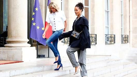 Rihanna is welcomed by the First Lady Brigitte Trogneux as she arrives for a meeting with French President Emmanuel Macron at Elysee Palace on July 26, 2017 in Paris, France.