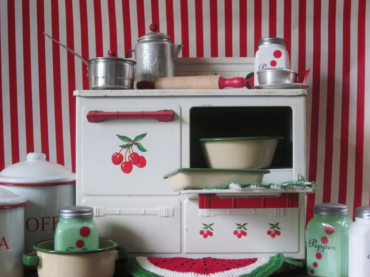 Vintage Toy Tin Play Stove Child Cherry Kitchen Mid Century Toy Christmas in July. $65.00, via Etsy.