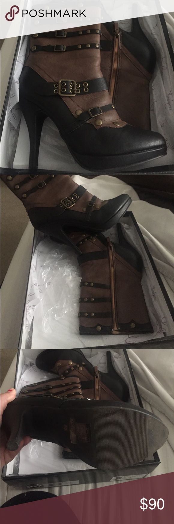 "4"" Steam Punk Boots size 10 Size 10, worn once for a charity function, still in box. Colors are black, & camel brown with brass hardware. Beautiful boots! Feel free to make me an offer, but please, no lowball offers- they will be declined. Thanks! Happy poshing!                🔥ONLY UNTIL SEPTEMBER 4th $70🔥 Shoes Heeled Boots"